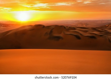 Sand dunes near Huacachina at sunset in Ica region, Peru.