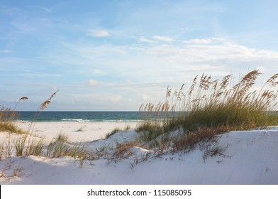 Sand dunes and ocean at sunset, Pensacola, Florida.