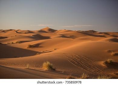 Sand Dunes in Sahara Desert in Merzouga, Morocco during sunset