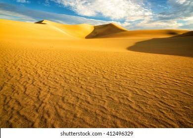 Sand dunes at sunrise in the Desert