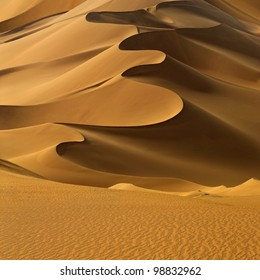 Sand dunes at sunset in the Sahara Desert, Libya.