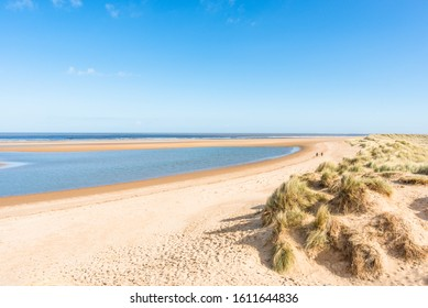 Sand dunes where Norfolk Coast path National Trail from Barnham Overy Staithe reaches the sea, East Anglia, England, UK.