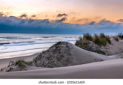 Sand dunes in a winter sunrise on the beautiful Outer Banks beaches in Corolla, North Carolina.