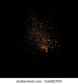 Sand explosion, dirt fly, dust isolated on black background