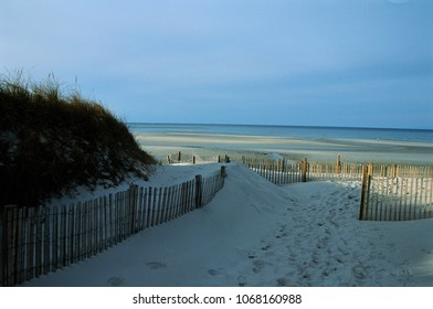 Sand fence entering Mayflower Beach, Dennis, MA.