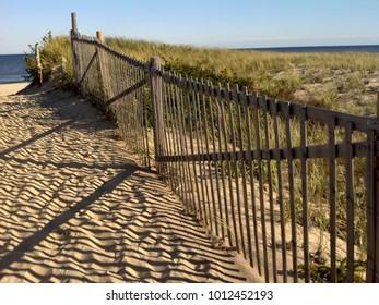 A sand fence at Nauset Beach, Orleans MA. on a sunny day