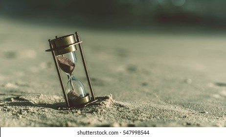Sand glass on a white beach. (vintage style)