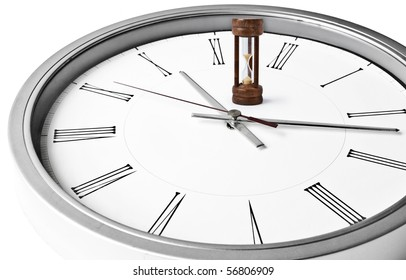 Sand glass and white clock