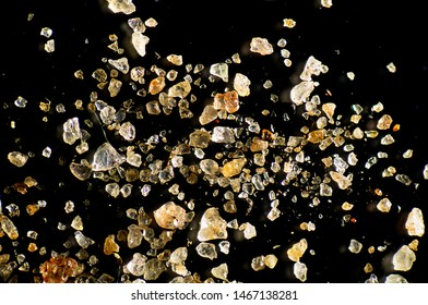 Sand grains from Lake Victoria in Uganda, Africa, at about 20x magnification using a microscope.
