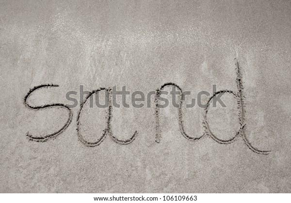 sand handwritten in sand on a beach