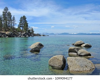 Sand Harbor hiking trails and scenic overlooks offer photographers and hikers the splendor of boulder studded turquoise water and regal pines against a backdrop of blue sky and the Sierras.
