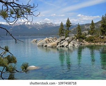 Sand Harbor offers hiking trails and scenic overlooks where photographers and hikers can take in the splendor of boulder studded turquoise water and regal pines against a backdrop of mountains.