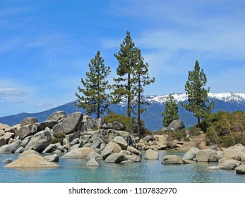 Sand Harbor offers hiking trails and scenic views where photographers and hikers can take in the splendor of boulder-studded turquoise water and regal pine trees against a backdrop of the Sierras.