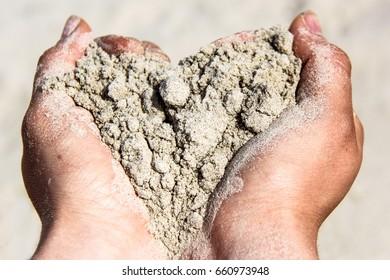 sand heart in hands