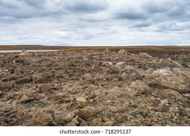 Sand and ice blocks blown out with a probably spontaneous methane explosion in the tundra close to Seyakha (Yamal, Russia)