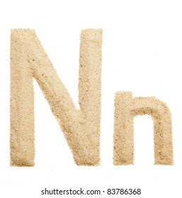 Sand letter isolated on white. One letter of Sand alphabet. Letter N