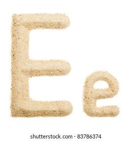 Sand letter isolated on white. One letter of Sand alphabet. Letter E