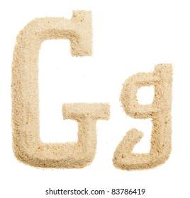 Sand letter isolated on white. One letter of Sand alphabet. Letter G