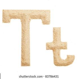 Sand letter isolated on white. One letter of Sand alphabet. Letter T