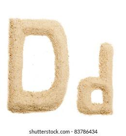 Sand letter isolated on white. One letter of Sand alphabet. Letter D