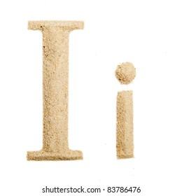 Sand letter isolated on white. One letter of Sand alphabet. Letter I