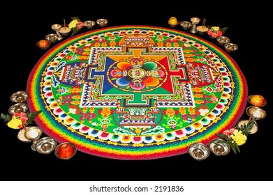 Sand Mandala made by Tashi Lhunpo Monastery monks, isolated on black background.
