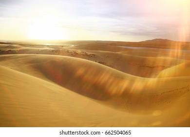 Sand mountains in the desert by day