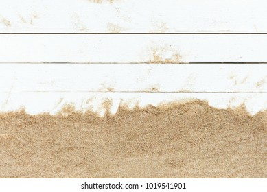 Sand on white wooden floor top view background,With copy space texture for holiday design background