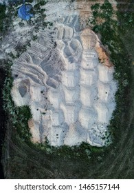 Sand piles on a construction site seen from above, photo taken by drone