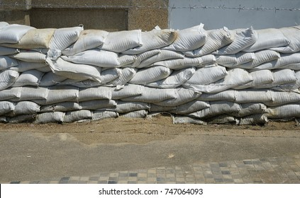 Sand in plastic bag, stack of sand bag wall, water flood protection in rainy season at Nonthaburi waterfront, Thailand.