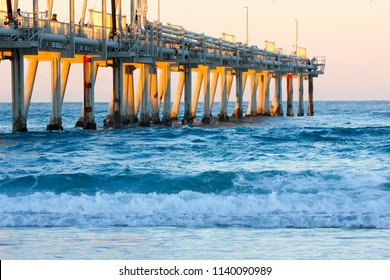 Sand pumping jetty at The Spit on the Gold Coast at sunset.
