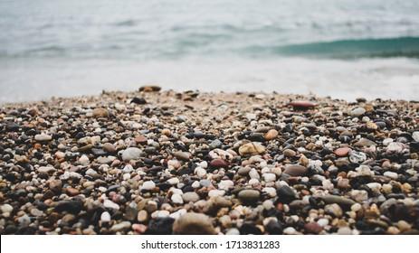 Sand and rocks of the beach. Peaceful sea