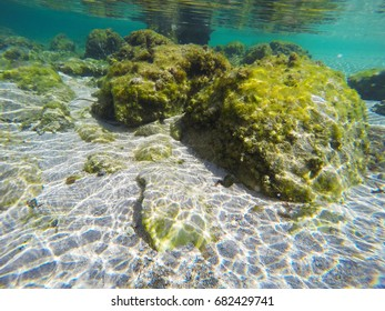 Sand and rocks seen underwater. Sardinia, Italy