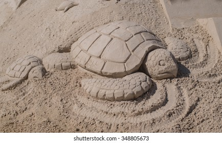 Sand Sculpture of a Mother Sea Turtle and Her Baby Sea Turtle on Fort Myers Beach