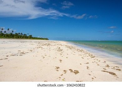 Sand and sea on the beach of Sao Miguel dos Milagres, Alagoas, Brazil.