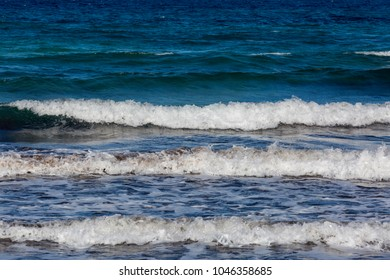 Sand and sea at a sandy beach in the Mediterranean