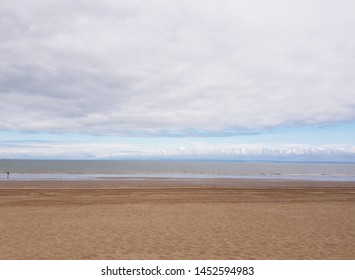 sand, sea and sky in the uk on a warm sunny day in Minehead, Somerset