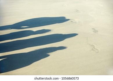 Sand, shadows on the beach