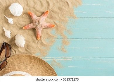 Sand and shells on the wooden floor of the blue,summer concept