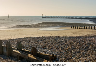 Sand and shingle beach with groynes at Littlehampton, West Sussex, England