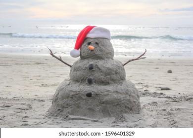 Sand Snowman with a Santa hat on Encinitas Beach in Southern California