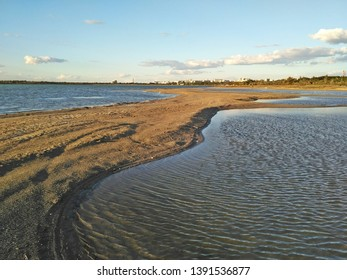 Sand spit on the lake Moinak in the Crimea in the rays of the sunset.