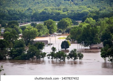 Sand Springs USA 5-25-2019 View from 412 Highway to the West of Tulsa Oklahoma as Arkansas river rises and innodates residential area with houses flooded and cars parked in water and a RV tipping over