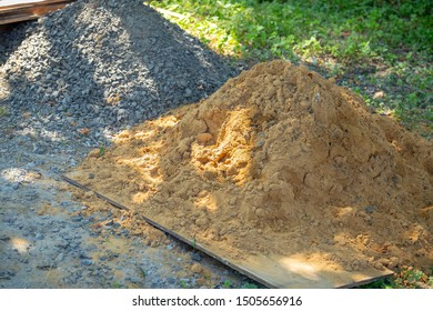 Sand and stone for construction work. A Sand and stone for construction work.