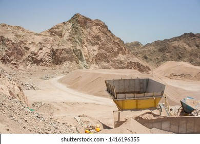 sand stone quarry in Middle East desert rocky scenery landscape place and disabled digging factory iron rusty peaces, industrial and global environmental pollution wallpaper pattern concept picture