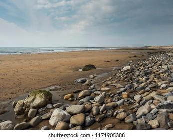 Sand and stones on Silver Strand Beach (Malin Beg) Sligo, county Donegal, Ireland.