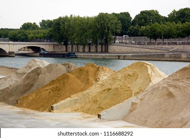 Sand stored on a dock of the Seine in Paris. Raw material in wait. (France)