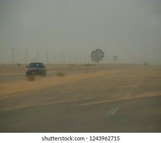 A sand storm hinders traffic on the Benghazi-Tripoli highway. The Arab Spring in Libya begins. April 7, 2011, Benghazi, Libya.