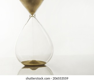 Sand Streams in a hour glass/Hour Glass/Vintage hand blown hour glass with sand streaming marking time