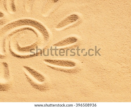 sand sun print on a beach in a summer sunset